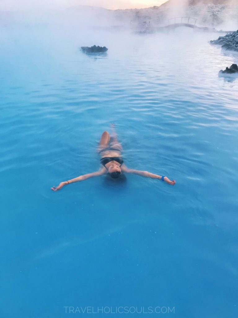 girl floats blue lagoon